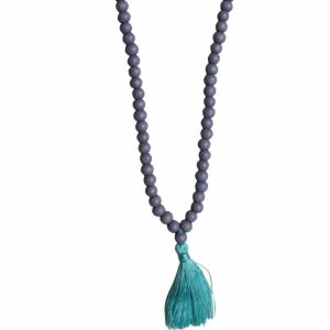grey wooden necklace with teal tassel